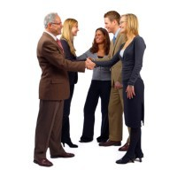 A business team shaking hands to seal a deal